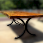 A finished sycamore table on a metal base.