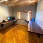 A unique office setup using walnut slabs for desks.