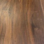 The finished grain on a walnut slab.