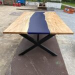 Maple slab river table with blue epoxy.