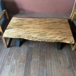 A wormy maple slab coffee table on display in our sawmill's office.