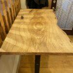 Ash wood slab as a desktop.