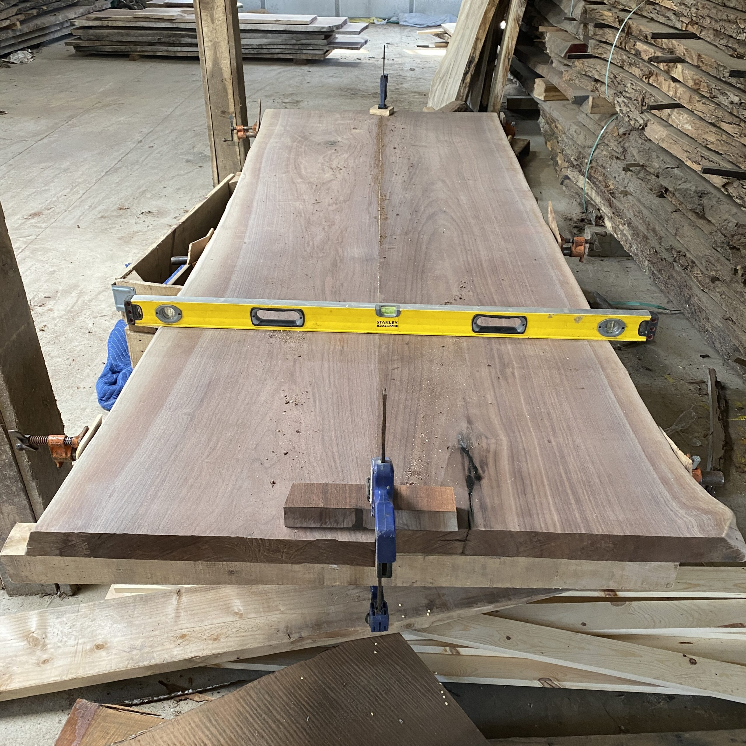holding the bookmatch slab top flat