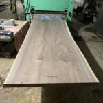 """A 105""""x42"""" bookmatched walnut slab table."""