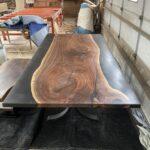 Walnut slab table with epoxy.